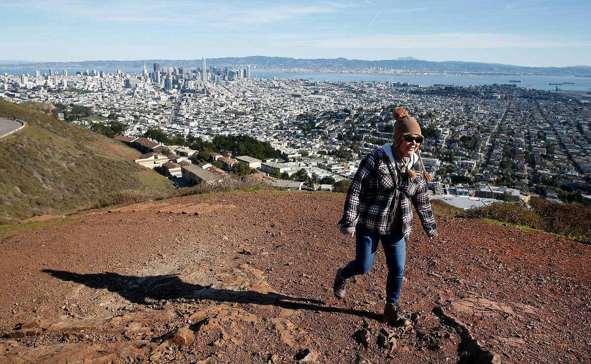 Terri Woo reaches the south summit of Twin Peaks in San Francisco, Calif. on Tuesday, Jan. 1, 2019. It�s the first time in two years that Woo has been able to make the trek after surviving a bout with cancer.