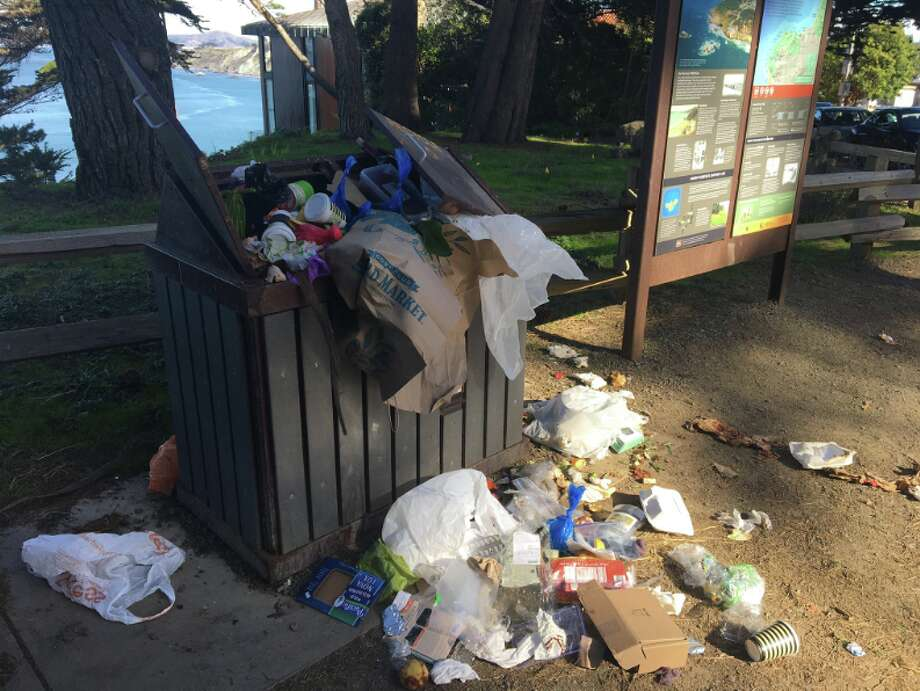 A garbage can at Lands End in San Francisco overflows with trash on Wednesday, January 2, 2018, amid a federal government shutdown that has sidelined maintenance crews in some federal lands. San Francisco Public Works has stepped up to help clean up some of the garbage in lands run by the National Park Service. Photo: SF Public Works