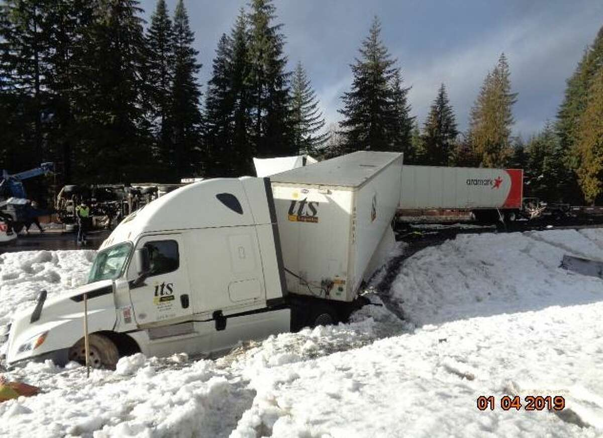 Photos of a crash scene on Interstate 90 about eight miles east of Snoqualmie Summit and nine miles west of Easton. At least one person died in the crash and an investigation was ongoing.