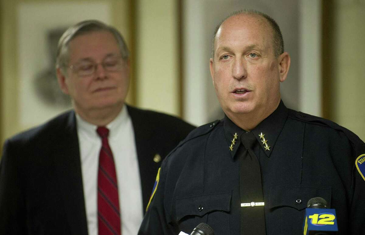 Police Chief Jon Fontneau speaks during a press conference with Mayor David Martin in 2015.