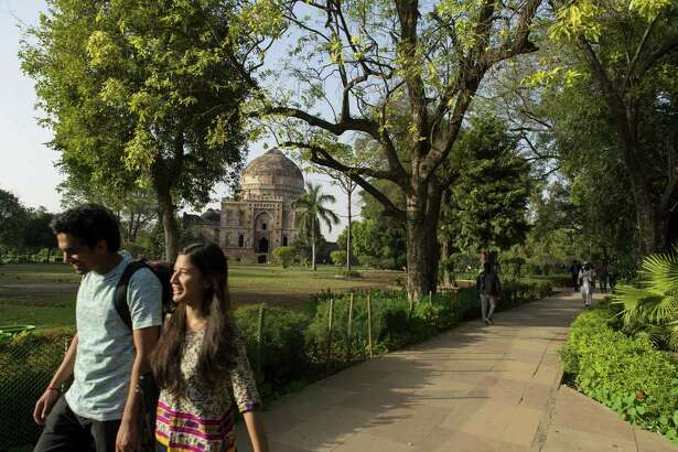 People spend leisurely time in the afternoon at Lodi Gardens. Lodhi Gardens is spread over 90 acres and contains the tombs of the monarchs of the Lodi dynasty who ruled northern India between 1451 and 1526. The big garden provides the people of Delhi a big relief as they enjoy fresh air amidst the hustle and bustle of city life.