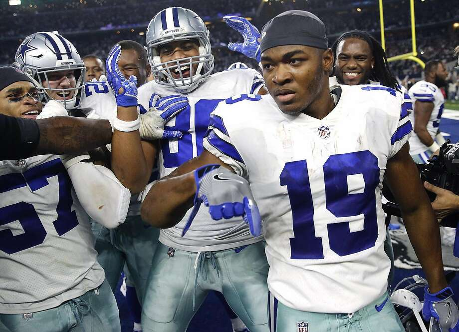 Dallas Cowboys wide receiver Amari Cooper is congratulated by teammates after scoring the game-winning touchdown in overtime on Dec. 9, 2018. Cooper responded Wednesday to a viral tweet that claimed he had been shot in the Dallas area. Photo: Tom Fox, TNS