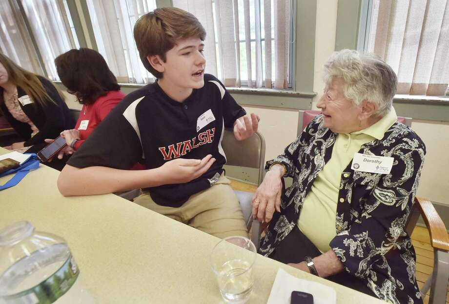 Sam Smith, 14, and Dorothy Ricker, 93, share a conversation in Branford, Conn. Shouldn't diversity goals take age into account? Photo: Peter Hvizdak /Hearst Connecticut Media / New Haven Register
