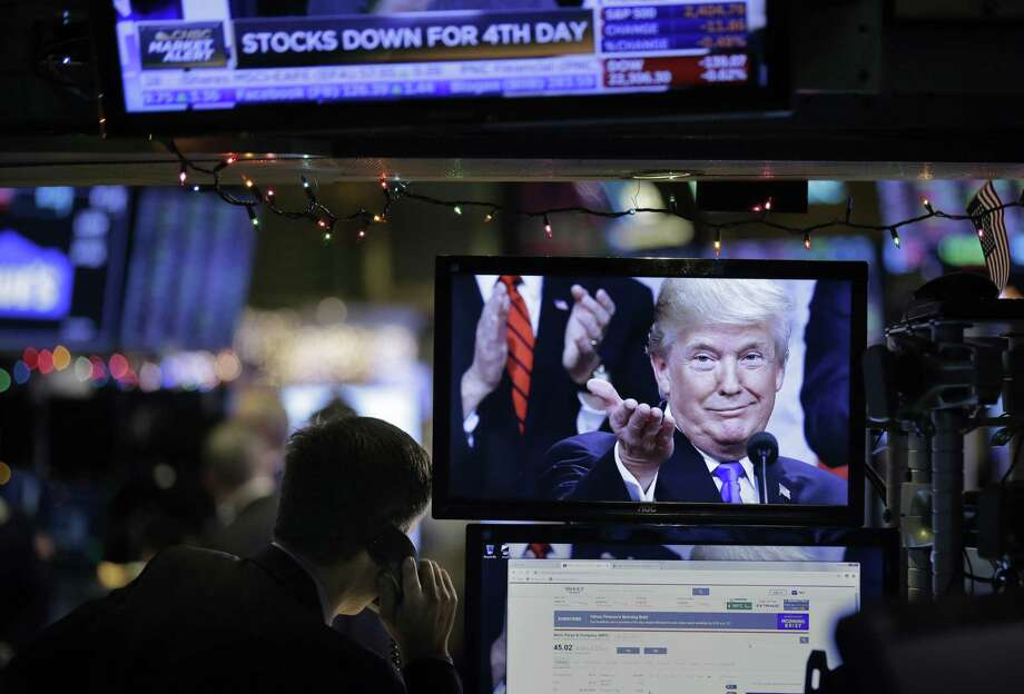 President Donald Trump is displayed on a computer on the floor of the New York Stock Exchange in New York on Dec. 24. The president should stop focusing so much on stock market performance and more on wages and productivity. Photo: Seth Wenig /Associated Press / Copyright 2018 The Associated Press. All rights reserved.