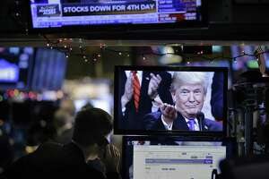 President Donald Trump is displayed on a computer on the floor of the New York Stock Exchange in New York on Dec. 24. The president should stop focusing so much on stock market performance and more on wages and productivity.
