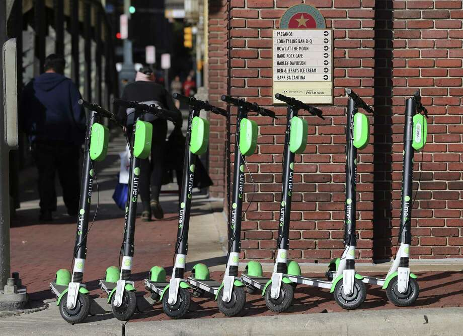 Scooter parking areas must not impede sidewalks and should be away from the path of pedestrians. Photo: Kin Man Hui /Staff Photographer / ©2018 San Antonio Express-News