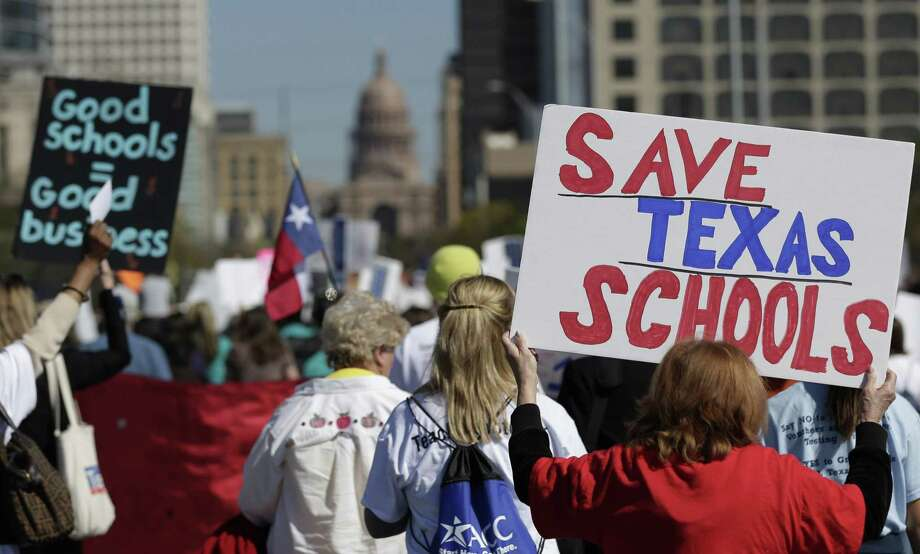 Teachers, students, parents and school administrators march up Congress Avenue as they take part in a rally for Texas public schools at the state Capitol Feb. 23, 2013, in Austin. The issue of state school financing persists and rightly belongs on the Legislature's priority list in the coming session. Photo: Eric Gay /AP / AP