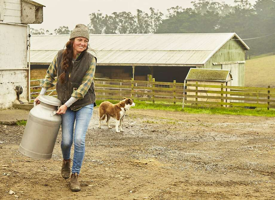 Hadley Kreitz of Toluma Farms and Tomales Farmstead Creamery hauls a milk jug at Marshall Home Ranch & Dairy in Tomales. She will bring the Jersey cow milk from Marin to Daily Driver, which will open in March as what could be San Francisco's very first creamery. It will also have a cafe. Photo: Frankie Frankeny