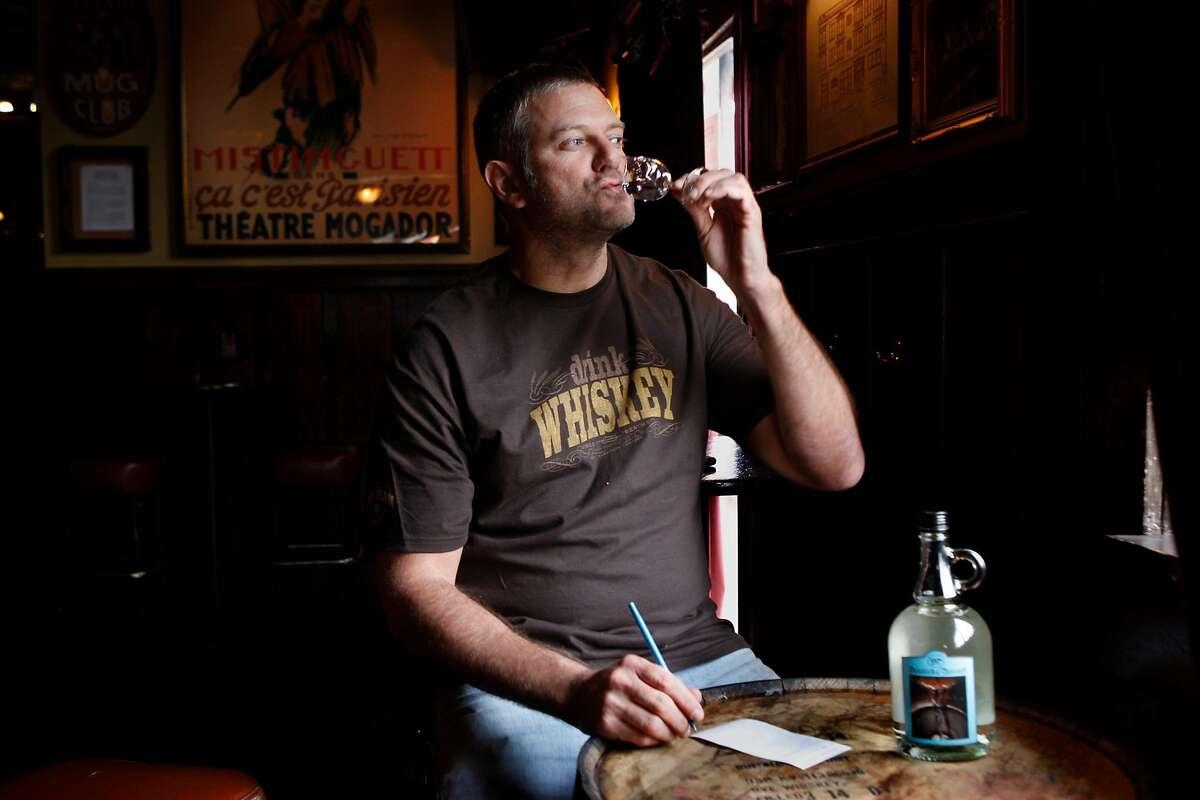 Elixir bar owner H. Joseph Ehrmann taste testing Marco K. Spirits' Doubled & Twisted IPA Whiskey Light for his blog on Wednesday, February 10, 2010, in San Francisco, Ca.