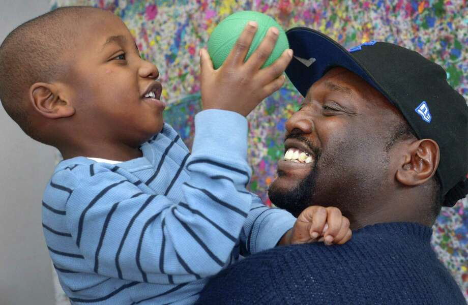 Norwalk resident Dexter Bryant and his two-year-old son, D.J. Bryant Friday January 4, 2019, at Family & Children's Agency in Norwalk, Conn. The Family & Children's Agency is forming a new fatherhood group called Circle of Security, open to all fathers with children younger than six. FCA staff created the group because they felt there are a lot of supports for mothers and families but not for fathers. Photo: Erik Trautmann / Hearst Connecticut Media / Norwalk Hour