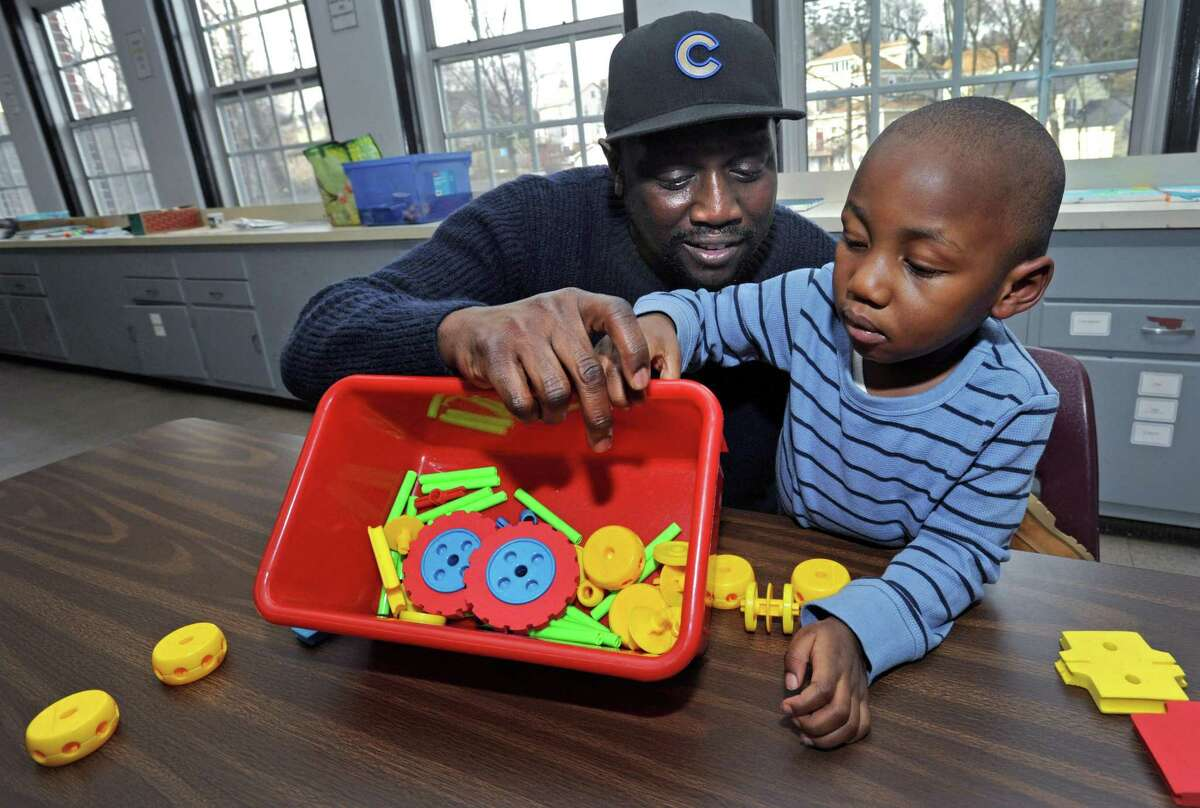 Norwalk resident Dexter Bryant and his two-year-old son, D.J. Bryant Friday January 4, 2019, at Family & Children's Agency in Norwalk, Conn. The Family & Children?'s Agency is forming a new fatherhood group called Circle of Security, open to all fathers with children younger than six. FCA staff created the group because they felt there are a lot of supports for mothers and families but not for fathers.