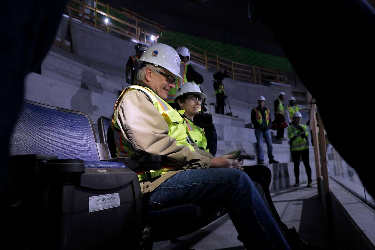 Season ticket holder Tim Leahy and his son Tyler take in the view from their new seats at the new Chase Arena still under construction in San Francisco on Friday, Jan. 4, 2019. The Warrior will open their 2019-2020 season in the new facility. Leahy was surprised by the Warriors with the offer to help install the seats.