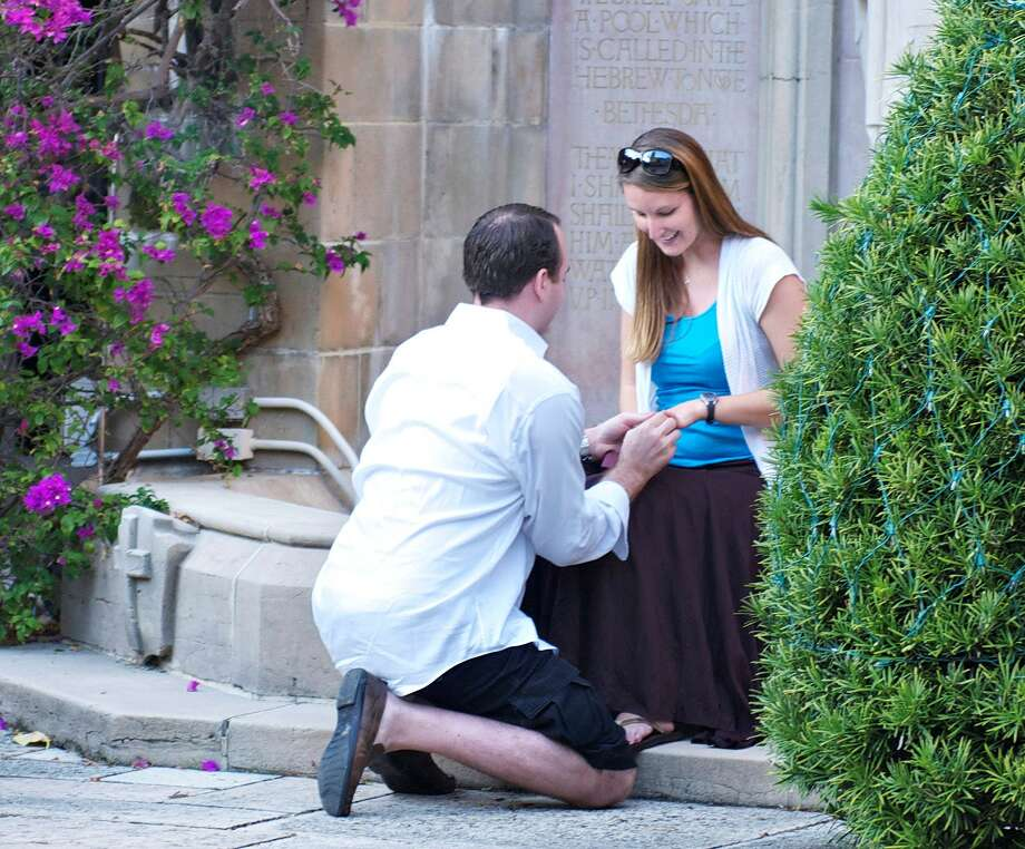 """Eight years after Ashley and David Barnosky of Cypress were engaged, the photographer who caught the moment on film without their knowledge was able to finally track the """"mystery couple"""" down. Photo courtesy Joy Groover Photo: Ashley Barnosky"""