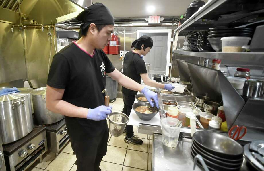 West Haven, Connecticut - Friday, January 4, 2019: Iishin Ramen Bar chef and co-owner Johnny Chen in his kitchen, left, at the recently opened ramen restaurant, the first in West Haven at the former location of Savin Rock Roasting Co. on Captain Thomas Boulevard. Photo: Peter Hvizdak / Hearst Connecticut Media / New Haven Register