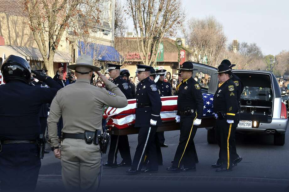 Law officers carry the casket of police Cpl. Ronil Singh in Newman. The officer was shot to death on Dec. 26 after he pulled over a suspected drunken driver. Photo: Deke Farrow / Modesto Bee
