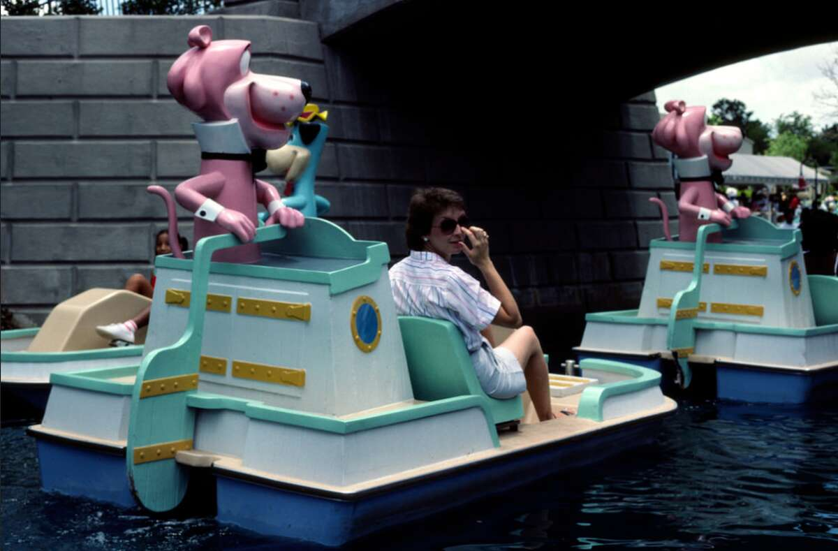 1984 Larry Syverson: Hanna Barbera Land was located in the northern suburbs of Houston, TX. It was only open in 1984 and 1985. We went both seasons. Two Pink Panther paddle boats with a Huckleberry Hound boat behind. The photo was taken in August 1984.