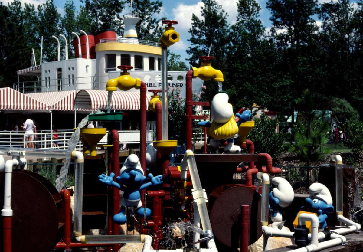 1984 Larry Syverson: Hanna Barbera Land was located in the northern suburbs of Houston, TX. It was only open in 1984 and 1985. We went both seasons. Smurfs at the ship. The photo was taken in August 1984.