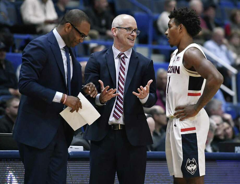 UConn head coach Dan Hurley, center, talks with Christian Vital, right as assistant coach Kimani Young, left, listens. Photo: Jessica Hill / Associated Press / Copyright 2018 The Associated Press. All rights reserved