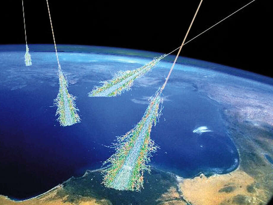 NASA: Have you ever been hit by a beam of high energy particles from above? Surely you have -- it happens all of the time. Showers of high energy particles occur when energetic cosmic rays strike the top of the Earth's atmosphere. Cosmic rays were discovered unexpectedly in 1912. It is now known that most cosmic rays are atomic nuclei. Most are hydrogen nuclei, some are helium nuclei, and the rest heavier elements. The relative abundance changes with cosmic ray energy -- the highest energy cosmic rays tend to be heavier nuclei. Although many of the low energy cosmic rays come from our Sun, the origins of the highest energy cosmic rays remains unknown and a topic of much research. This drawing illustrates air showers from very high energy cosmic rays. Cosmic rays may even be important to Earth's weather -- common lightning may be triggered by passing cosmic rays.