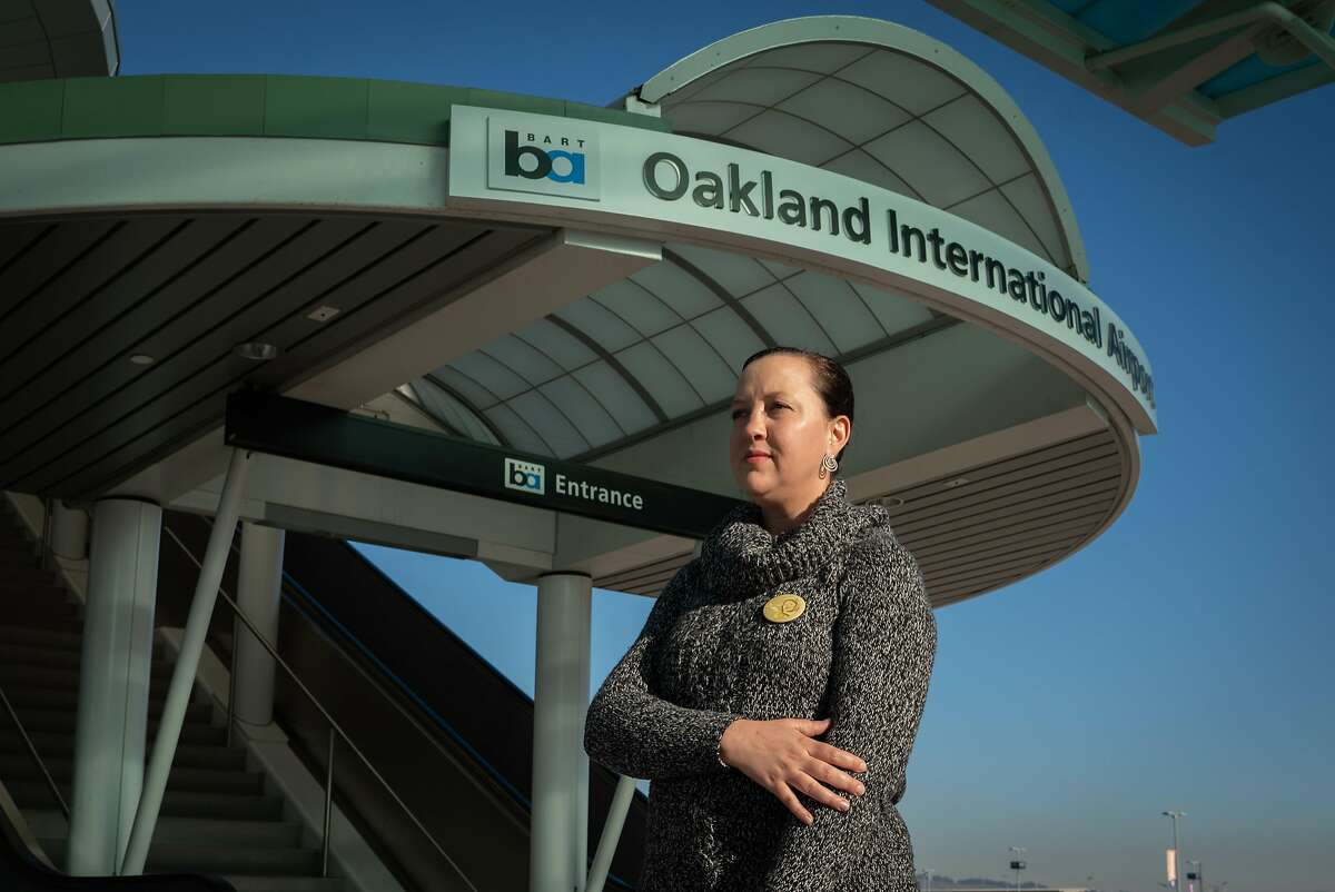 Tiffany Miller of Walnut Creek, poses for a photo near the Oakland International Airport in Calif., on Friday, Dec. 7, 2018. Miller is campaigning to change the name of Oakland International Airport to Maggie Gee International Airport, named after a Chinese Women Airforce Service Pilot in World War II.