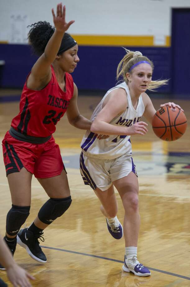 Midland High's Taysha Rushton is guarded by Tascosa's Aubry Nash 01/04/19 as Rushton looks to pass at Midland High gym. Tim Fischer/Reporter-Telegram Photo: Tim Fischer/Midland Reporter-Telegram