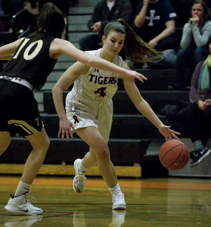 Ridgefield's Katie Flynn looks to dribble past a Trumbull player during Thursday's game. Photo: Scott Mullin / For Hearst Connecticut Media / Greenwich Time Contributed