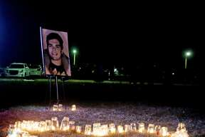 """Hundreds of people gathered, Friday at Cass City High Schoo, for a candlelight ceremony to honor Parker Haire, who died unexpectedly on Tuesday. Those in attendance helped spell out """"Parker"""" with candles. Everyone joined hands as a prayer was said. Afterwards, some silently reflected on Haire's life, while others shared memories over a cup of hot chocolate."""