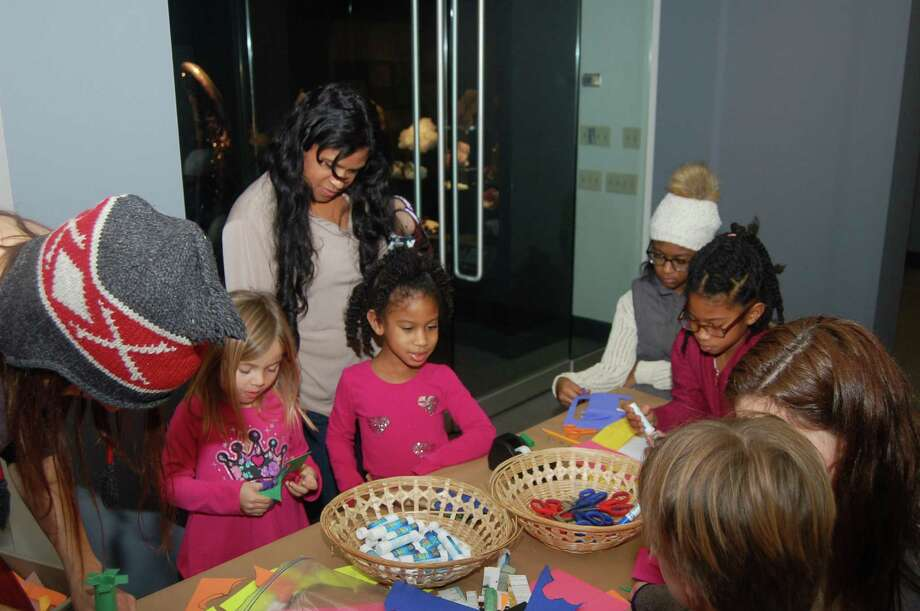 Children take part in Martin Luther King Jr. Day activities at the Bruce Museum last year. Photo: Contributed /