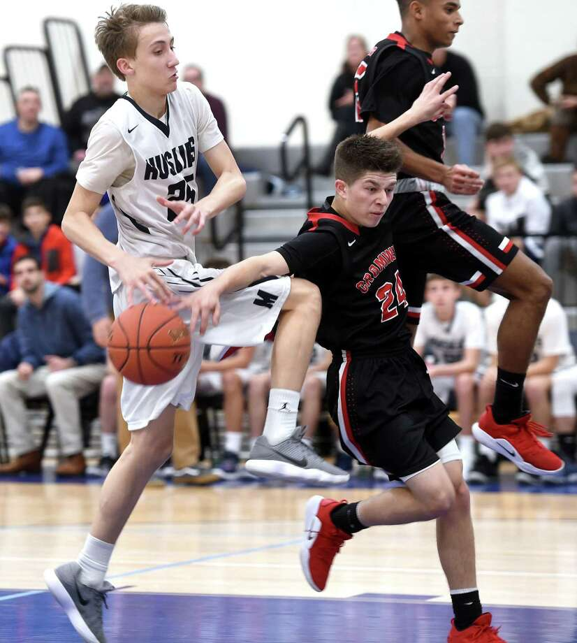 Morgan's Zach Johnson, left, of Morgan has the ball knocked loose by Cromwell's Tyler Baldwin on Friday. Photo: Arnold Gold / Hearst Connecticut Media / New Haven Register