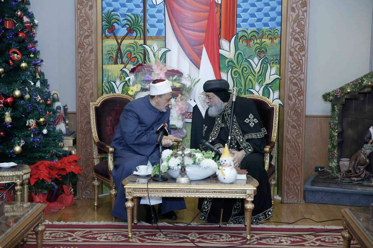 This handout picture released by the media office of Egypt's Al-Azhar mosque on January 2, 2018 shows the Azhar Grand Imam Ahmed al-Tayeb (L) meeting with Egypt's Pope Tawadros II, the Coptic Orthodox Patriarch of Alexandria on the Holy See of Saint Mark, at St Mark's Cathedral in the capital Cairo, as the former congratulates the latter ahead of the Coptic Orthodox celebrations of Christmas yet to take place on January 7. (Photo by Handout / AL-AZHAR MEDIA CENTRE / AFP)HANDOUT/AFP/Getty Images