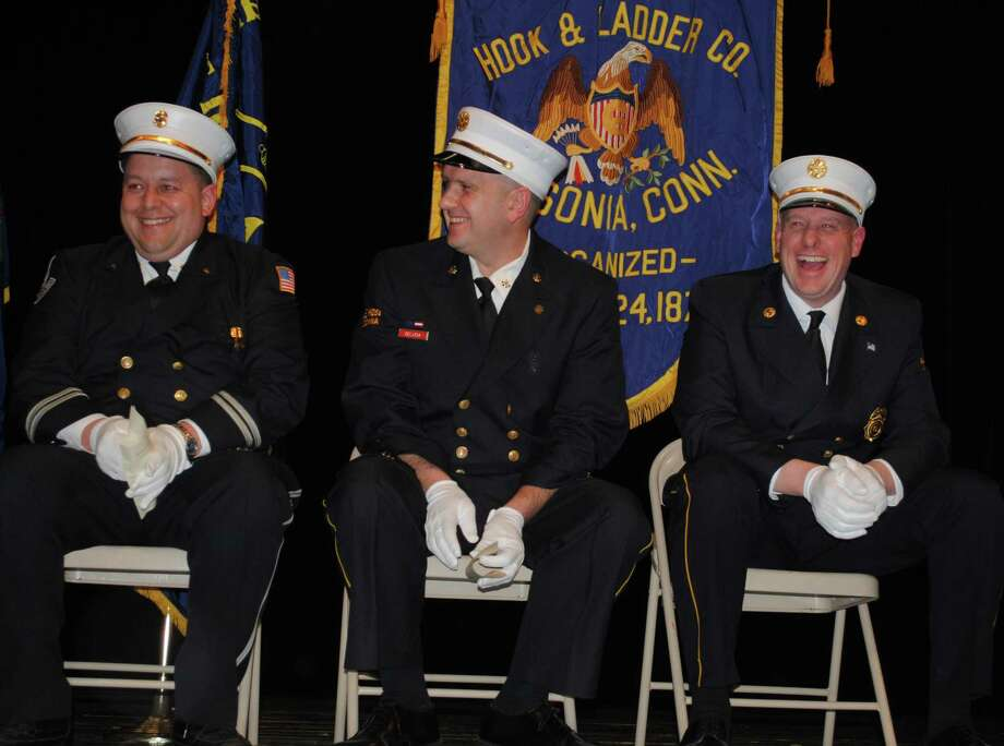 Third Assistant Chief Jay Fainer, Fourth Assistant Chief Anthony DeLucia and outgoing Fire Chief Ed Adamowski share a laugh Friday, Jan. 4, 2019, during the swearing-in of new Fire Chief Michael Eheman at Ansonia High School Photo: Viktoria Sundqvist / Hearst Connecticut Media /