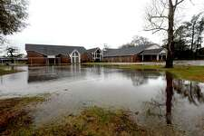 Land surrounding First Basptist Church in Deweyville began flooding following days of heavy rain and an expected increased dam release at Toledo Bend by the Sabine River Authority. The river had already begun to rise, extending into surrounding low-lying areas, and streets and yards throughout the community had begun to take on water by Thursday afternoon. Photo taken Thursday, January 3, 2019 Photo by Kim Brent/The Enterprise