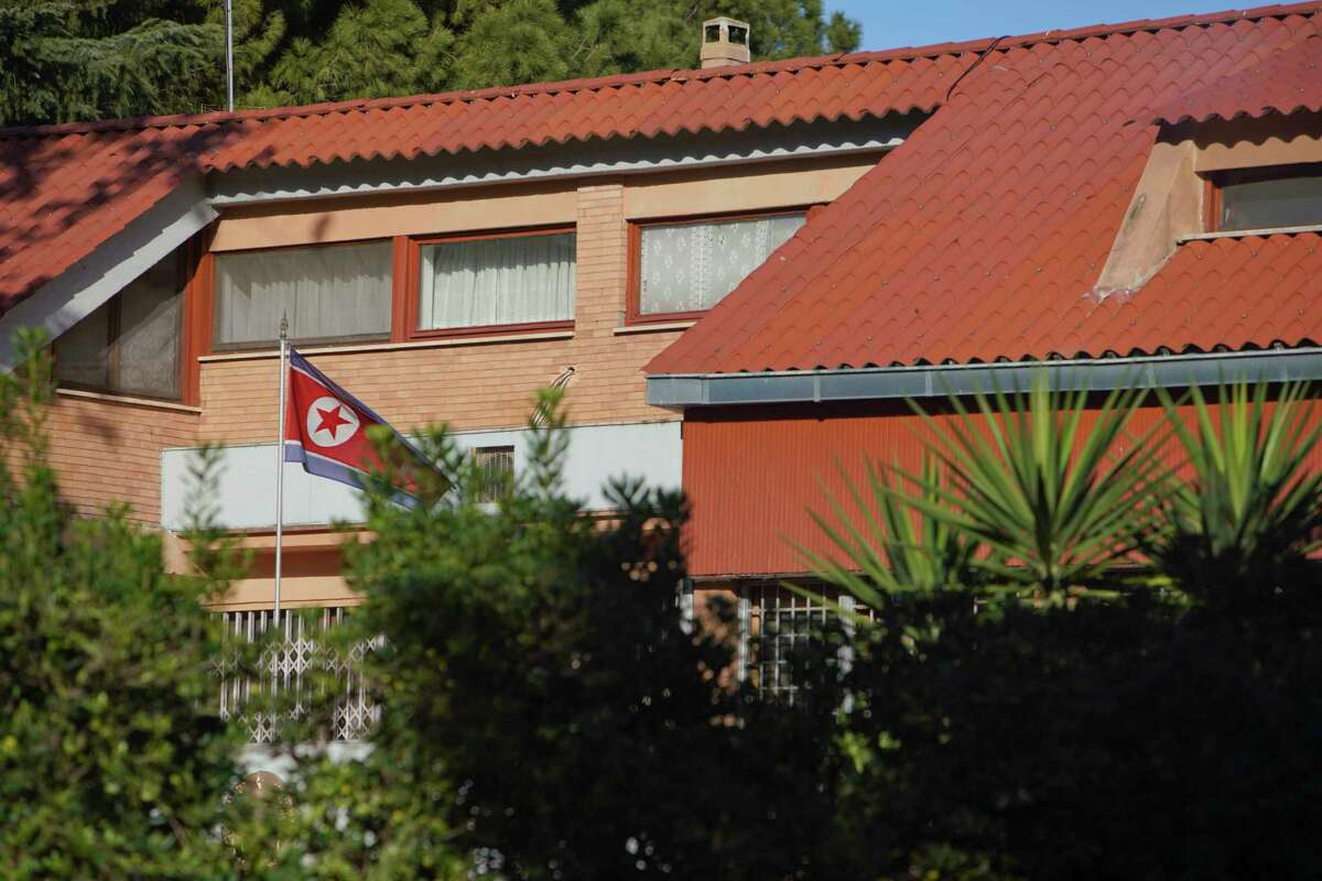The flag of North Korea waves inside the compound of the North Korean embassy in Rome, Thursday, Jan. 3, 2018. North Korea's acting ambassador to Italy, Jo Song Gil, went into hiding with his wife in November, South Korea's spy agency told lawmakers in Seoul on Thursday. (AP Photo/Andrew Medichini)