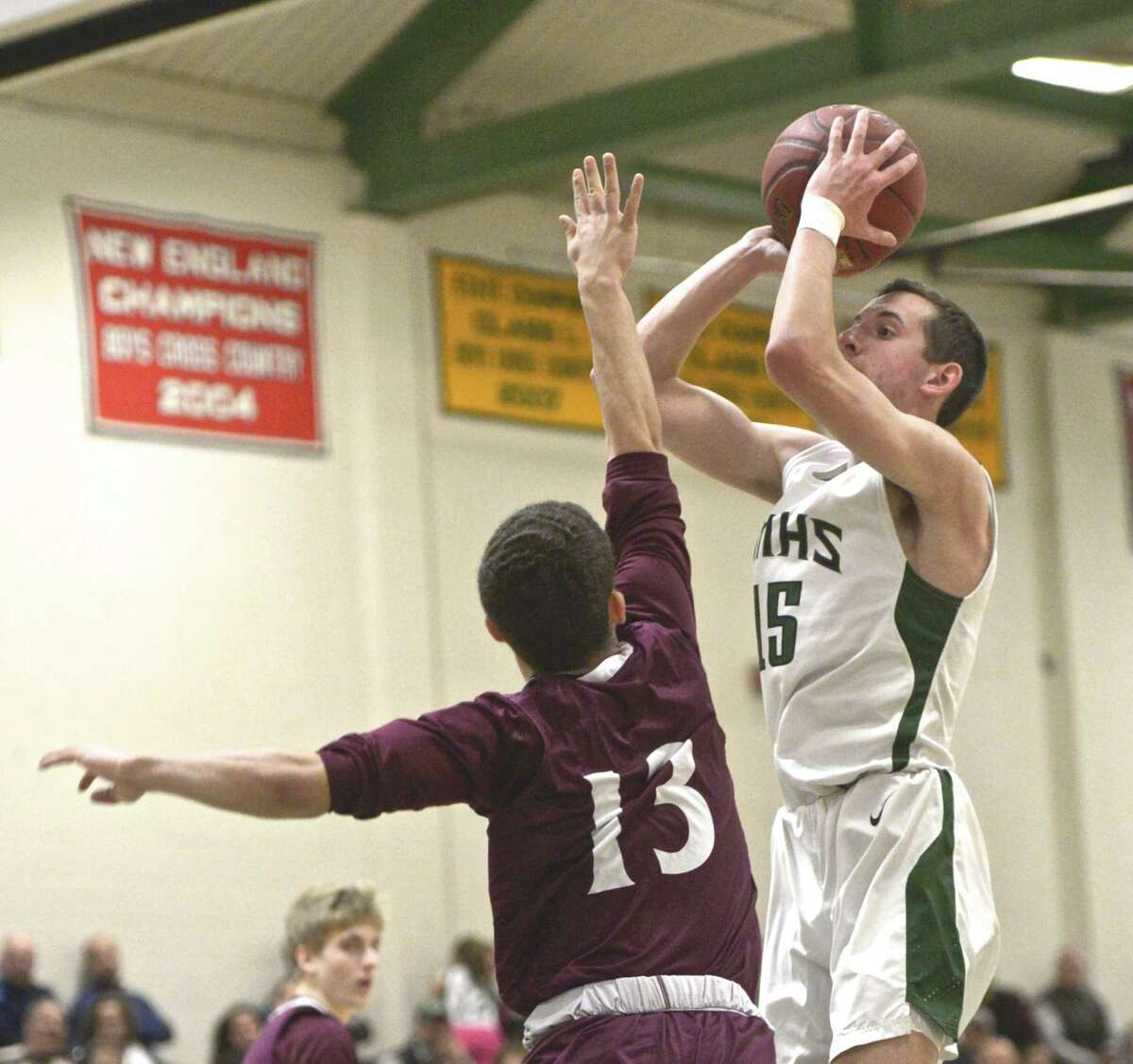 New Milford's Nicolas Maiurro (15) shoots over Bethel's Tyler Bowe (15) in the boys basketball game between Bethel and New Milford high schools, Friday night, January 4, 2019, at New Milford High School, New Milford, Conn.