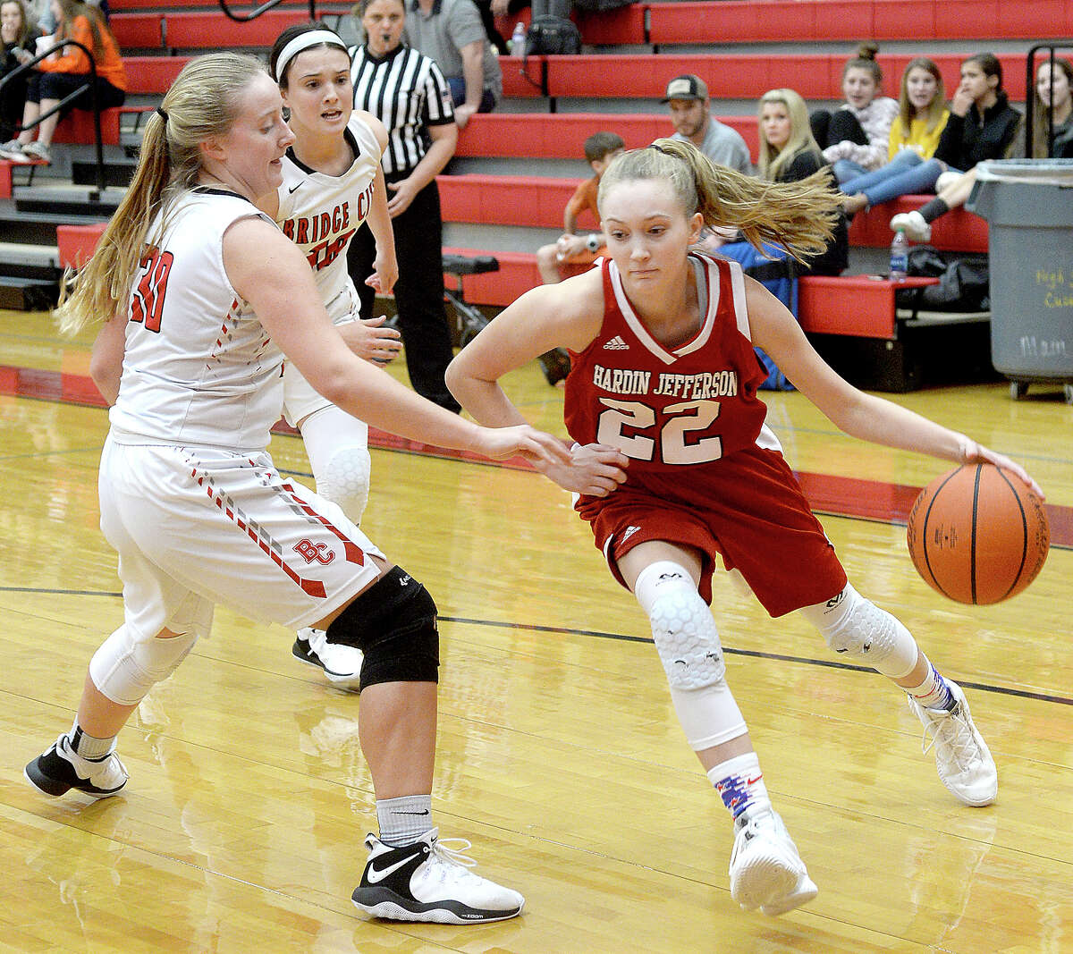 Bridge City's Madison Fischer paces Hardin-Jefferson's Makenna Henry during their match-up Friday at Bridge City. Photo taken Friday, January 4, 2019 Photo by Kim Brent/The Enterprise