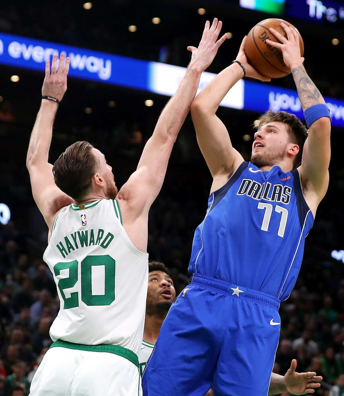 BOSTON, MASSACHUSETTS - JANUARY 04: Luka Doncic #77 of the Dallas Mavericks takes a shot against Gordon Hayward #20 of the Boston Celtics during the first half at TD Garden on January 04, 2019 in Boston, Massachusetts. NOTE TO USER: User expressly acknowledges and agrees that, by downloading and or using this photograph, User is consenting to the terms and conditions of the Getty Images License Agreement. (Photo by Maddie Meyer/Getty Images)
