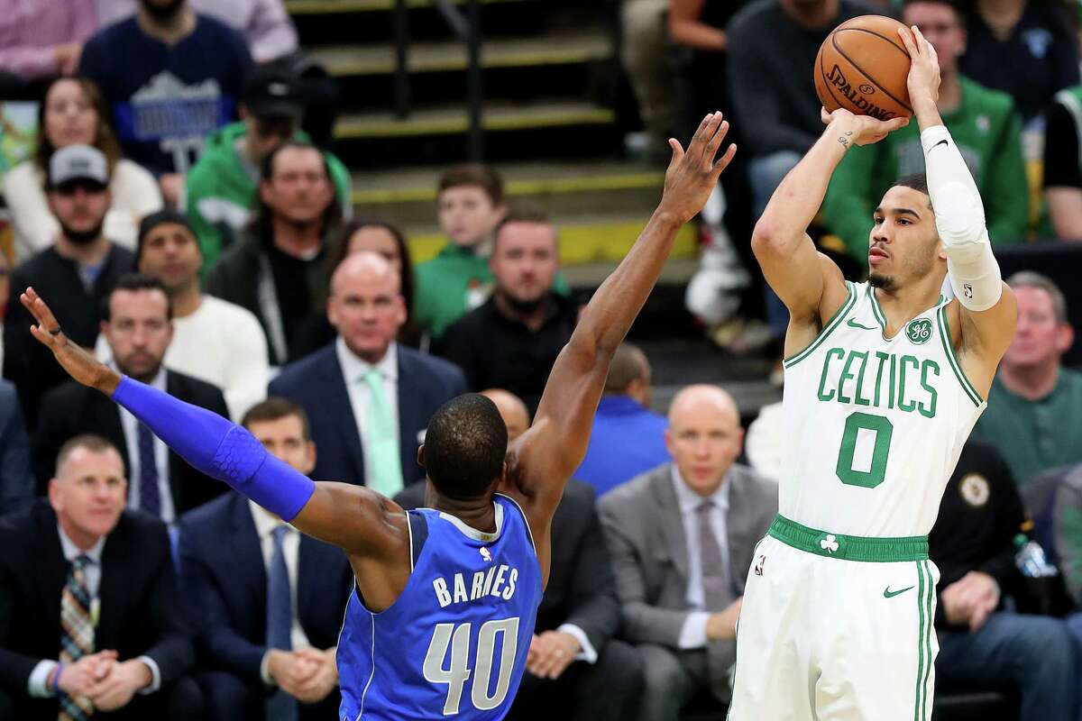 BOSTON, MASSACHUSETTS - JANUARY 04: Jayson Tatum #0 of the Boston Celtics takes a shot over Harrison Barnes #40 of the Dallas Mavericks during the first half at TD Garden on January 04, 2019 in Boston, Massachusetts. NOTE TO USER: User expressly acknowledges and agrees that, by downloading and or using this photograph, User is consenting to the terms and conditions of the Getty Images License Agreement. (Photo by Maddie Meyer/Getty Images)