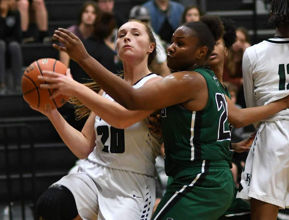 Kingwood Park's Shelby Rollo (20) drives to the hoop against Huntsville during the first quarter of their District 20-5A matchup at Kingwood Park High School on January 4, 2019.
