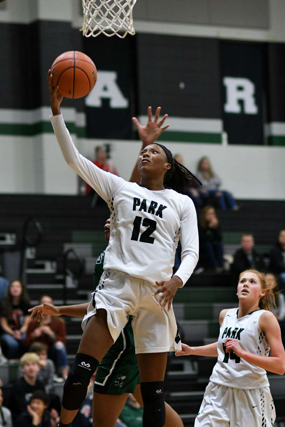 Kingwood Park's Allie Byrd (12) drives to the hoop against Huntsville during the first quarter of their District 20-5A matchup at Kingwood Park High School on January 4, 2019.