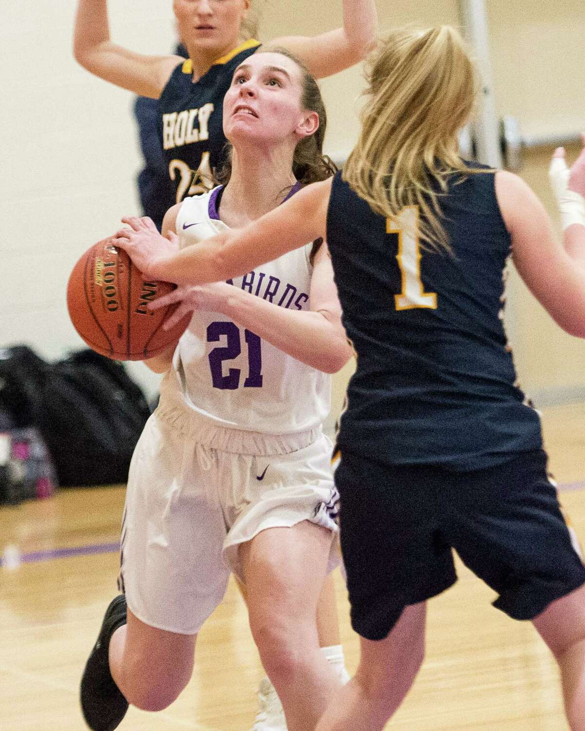 Voorheesville's Jennifer Bogart drives to the basket against Holy Names on Friday, Jan. 4. (Jim Franco / Special to the Times Union)