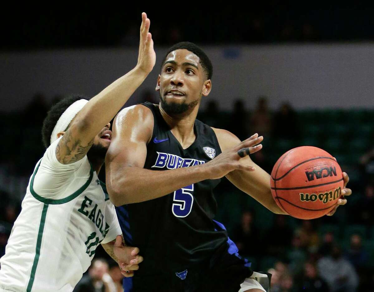 Buffalo guard CJ Massinburg (5) drives to the basket against Eastern Michigan guard Malik Ellison during the second half of an NCAA college basketball game Friday, Jan. 4, 2019, in Ypsilanti, Mich. (AP Photo/Duane Burleson)