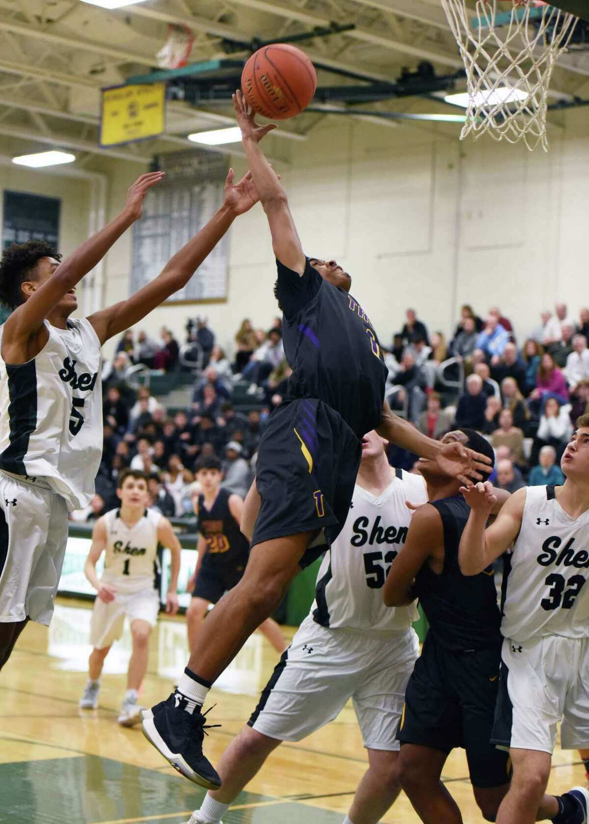 Troy's Makal Cruel jumps up toward the net during a game against Shenendehowa Friday, Jan. 4, 2019 at Shenendehowa High School in Shenendehowa, N.Y. (Phoebe Sheehan/Times Union) ORG XMIT: 20045837A