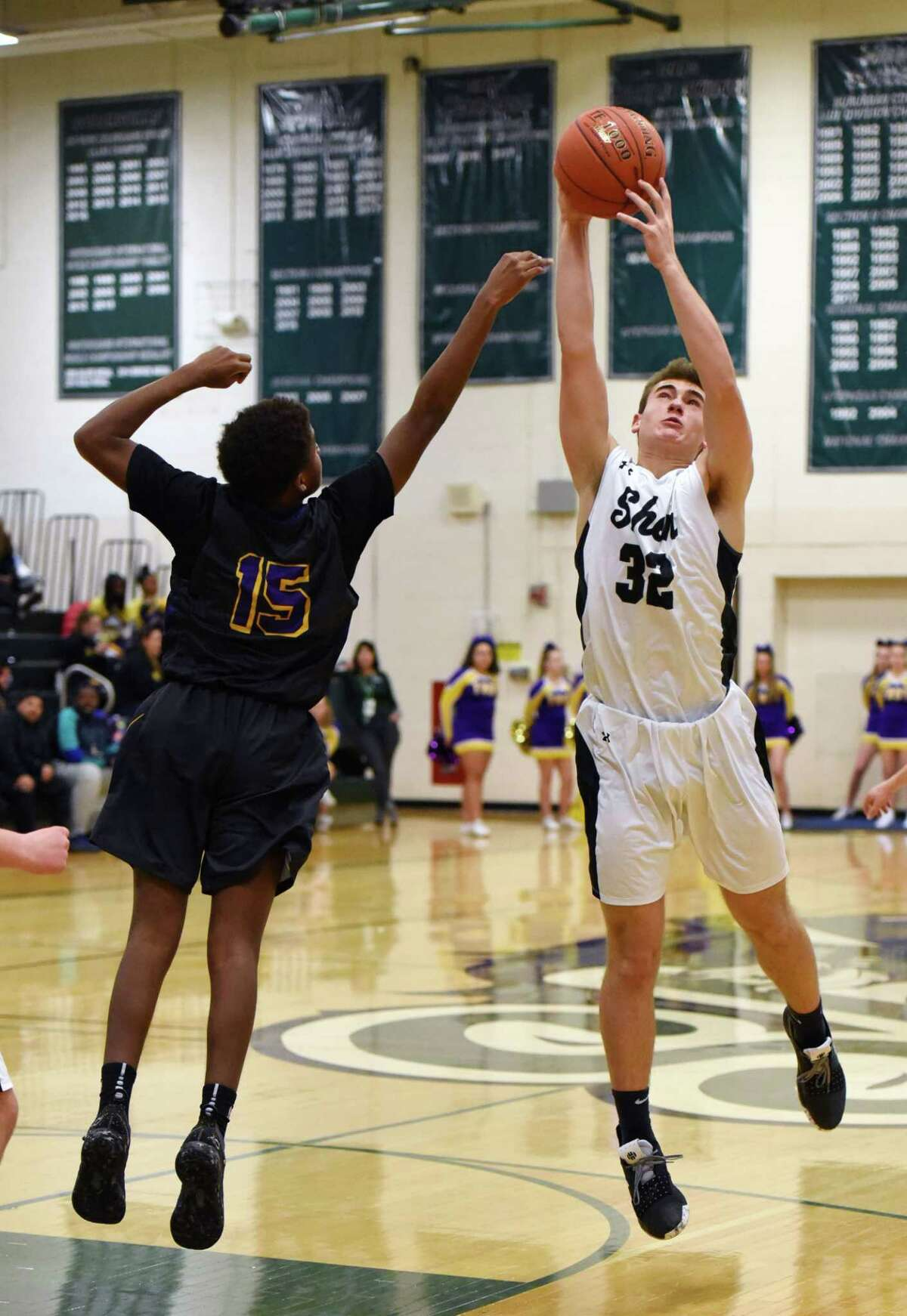 Shenendehowa's Jake Reinisch gains control over the ball during a game against Troy Friday, Jan. 4, 2019 at Shenendehowa High School in Shenendehowa, N.Y. (Phoebe Sheehan/Times Union) ORG XMIT: 20045837A