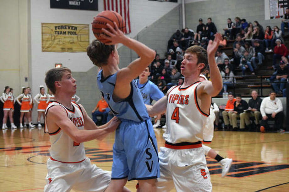 South County's Luke Shumacher (2) and Luke Bergschneider (4) attempt to block a player during a game against Sangamon Valley Friday in Waverly. The Vipers won 67-37. Photo: Audrey Clayton | Journal-Courier