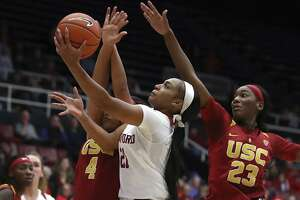 Stanford's DiJonai Carrington, center, lays up a shot between Southern California's Mariya Moore (4) and Asiah Jones, right, during the second half of an NCAA college basketball game Friday, Jan. 4, 2019, in Stanford, Calif. (AP Photo/Ben Margot)