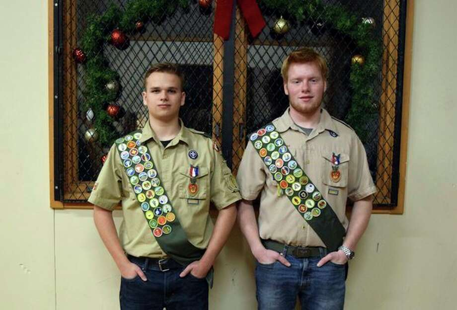Jared Keskey, left, and Charles Tucker from Boy Scout Troop 760 of Trinity Lutheran Church were awarded Eagle Scout rank during a Dec. 18 ceremony atthe church'syouth center. (Photo provided)