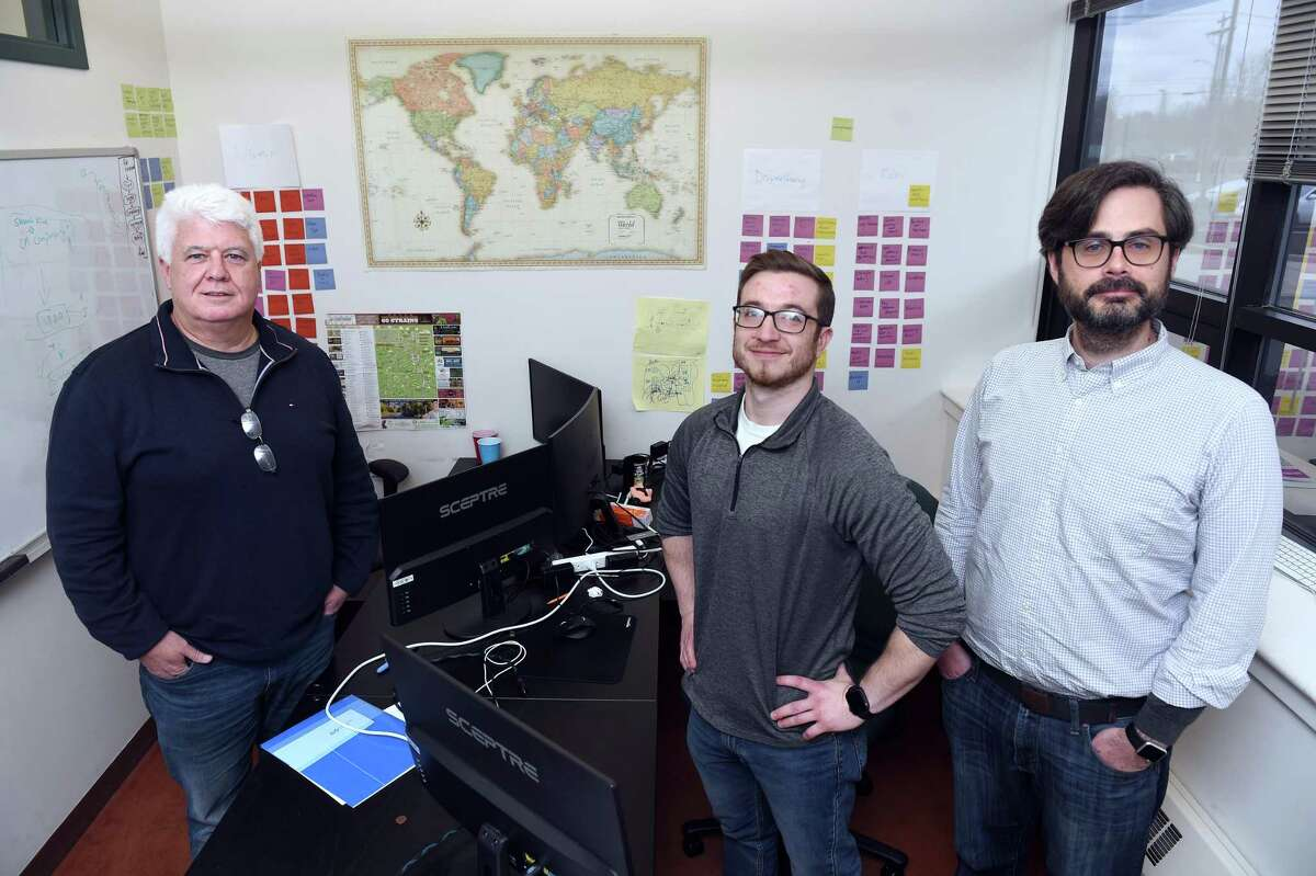 From left, Kevin Hart, founder and president of Green Check Verified; Mike Kennedy, director of product strategy; and Paul Dunford, director of customer experience, are photographed in their Science Park offices in New Haven.