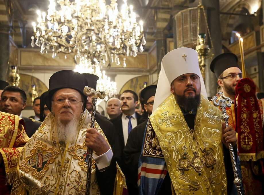 "Bartholomew I (left), the ecumenical patriarch of Constantinople, and Metropolitan Epiphanius I attend the ""Tomos"" independence decree signing ceremony in Istanbul. Photo: Emrah Gurel / Associated Press"