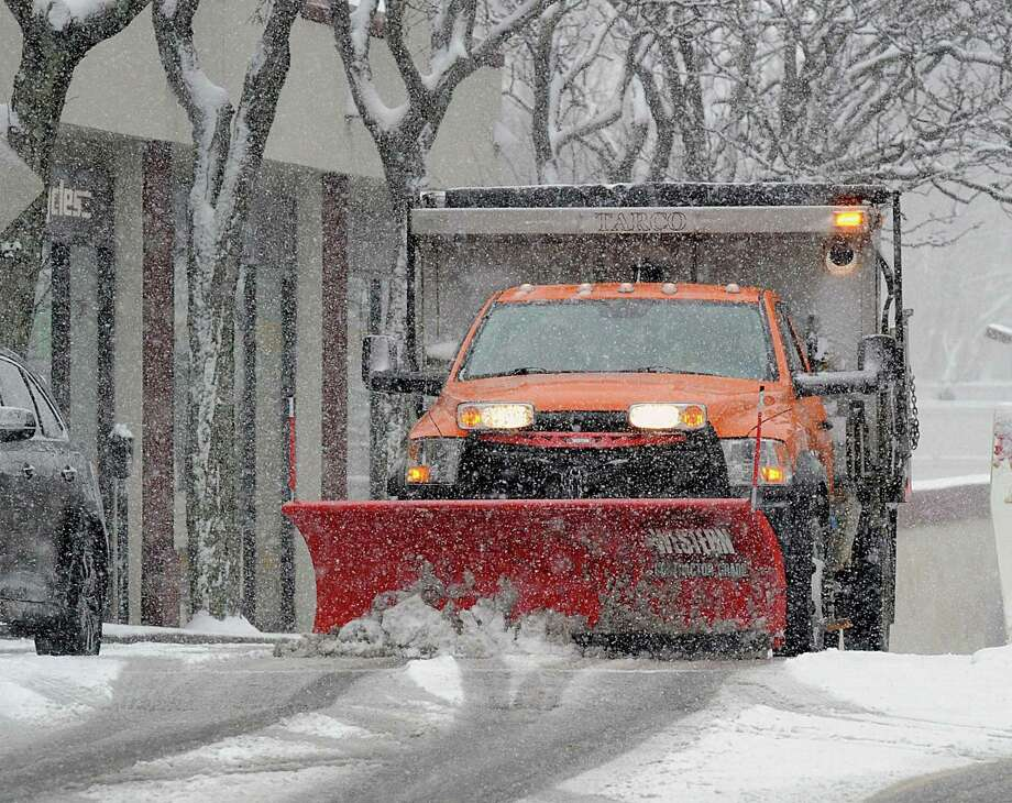 A plow truck clears snow on Railroad Avenue during the snowstorm that hit Greenwich, Conn., Wednesday, March 21, 2018. Photo: Bob Luckey Jr. / Hearst Connecticut Media / Greenwich Time