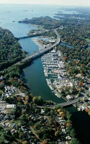 Geoff Steadman This aerial view of the Mianus River flowing into Cos Cob Harbor, traversed by the Post Road, I-95 and the New Haven Railroad, is on display in Town Hall with others showing the 27 mile coastline of the Town of Greenwich. The photographs were taken to illustrate a major report that will soon be completed on the Town's navigational waters. Photo: Contributed Photo / Greenwich Citizen